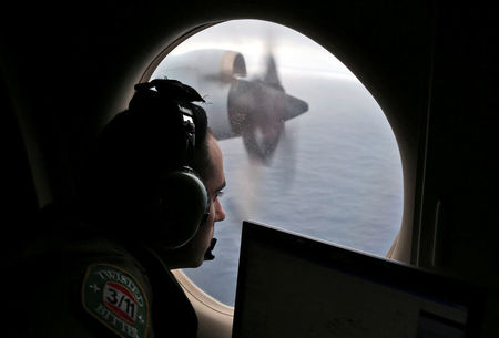 MH370 search team raises prospect plane could lie elsewhere