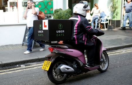 Uber launches global assault on food delivery market