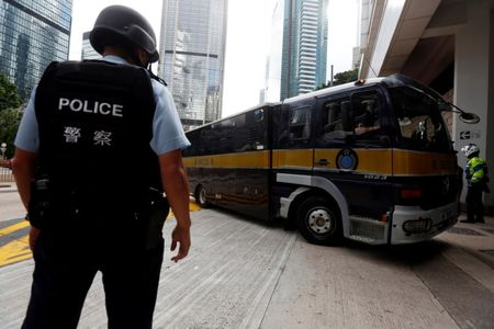 Hong Kong jury to see 'torture' video as British banker's trial begins