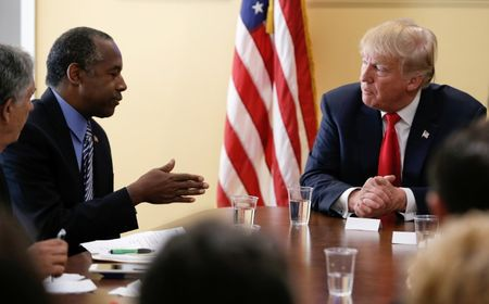 After hesitation, Carson accepts Trump's offer to head U.S. housing department