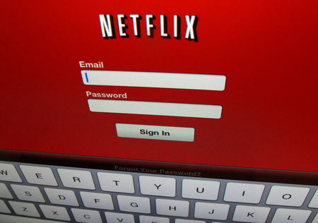 Netflix adds a third more subscribers than expected; shares jump eight percent