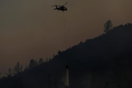Firefighters gain on California wildfire, some evacuees return
