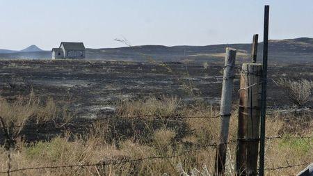 Montana blaze rages as California crews gain ground on wildfire