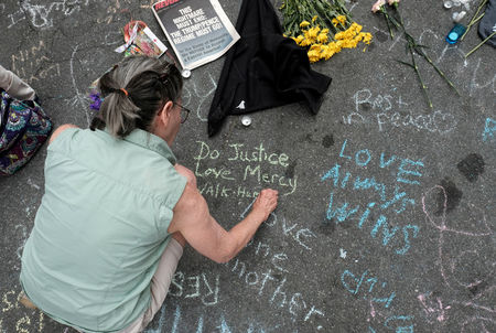Chalked messages show Charlottesville's shock after weekend violence