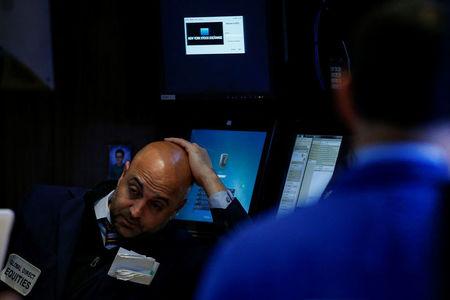 Dow strikes record high as broader market weakens