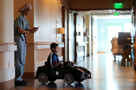 Hospital allow kids to drive themselves to operating room