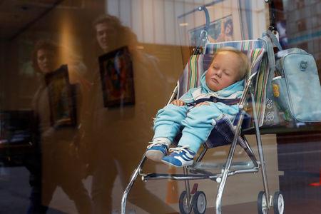 'That's art?' Baby turns heads in Manhattan auction house window