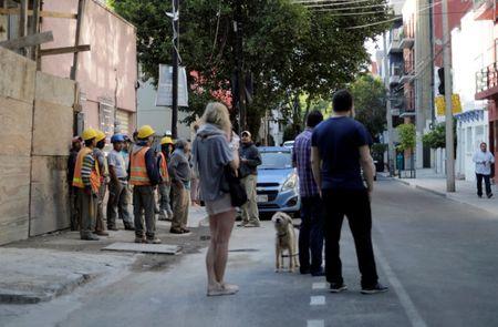 Mild earthquake shakes Mexico City, residents evacuate buildings