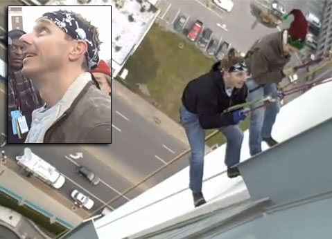 Video: Cashman climbs down building in advance of Santa show