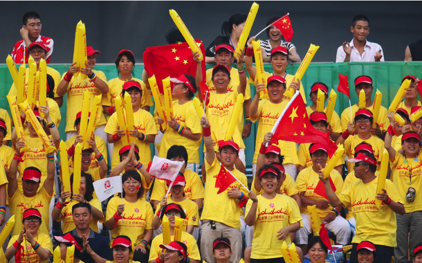 Volunteer 'fans' fill the stands in Beijing