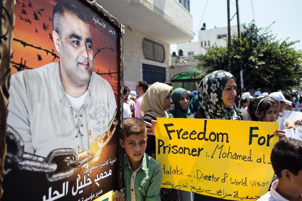 Give arrested aid worker fair trial, Amnesty tells Israel