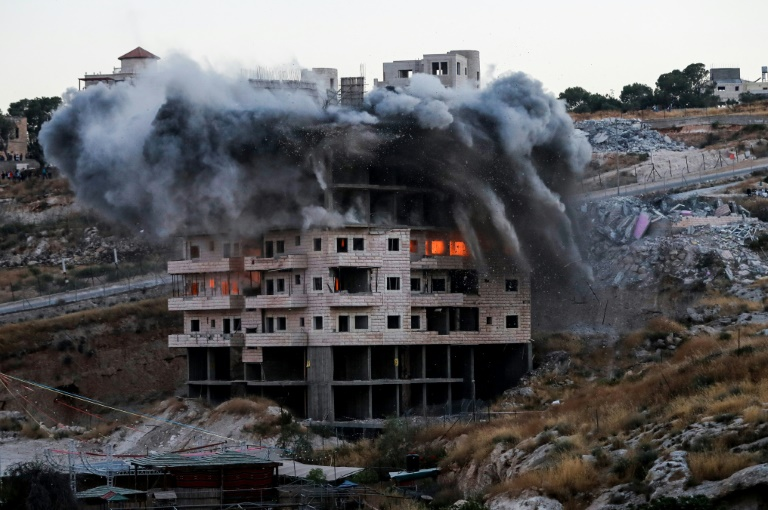 Israel says 12 Palestinian buildings destroyed in controversial demolition