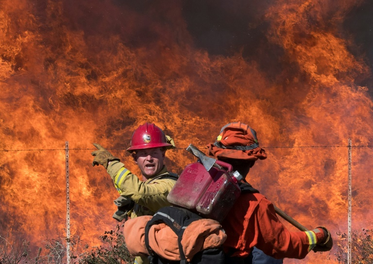 California fires: new blazes as dangerous winds fan the flames