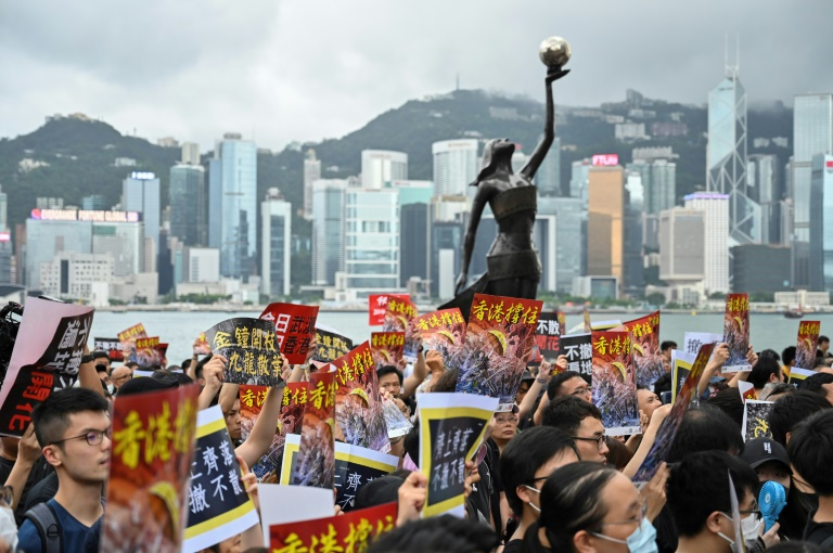 Hong Kong protesters march on station to educate Chinese mainlanders