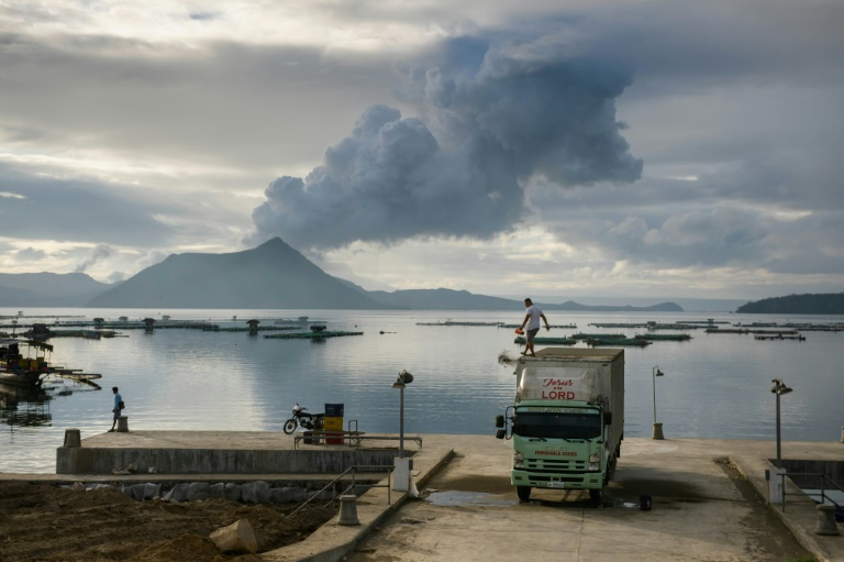 Philippines lowers volcano alert, thousands can return home
