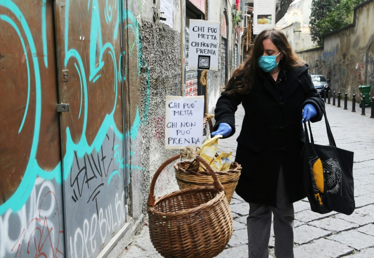 Italy sees signs of hope despite 766 new virus deaths