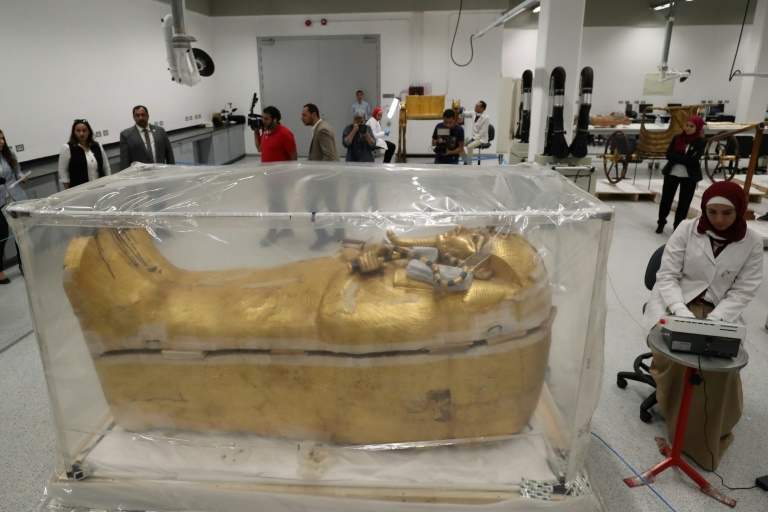 Egypt displays restoration of Tutankhamun gilded coffin