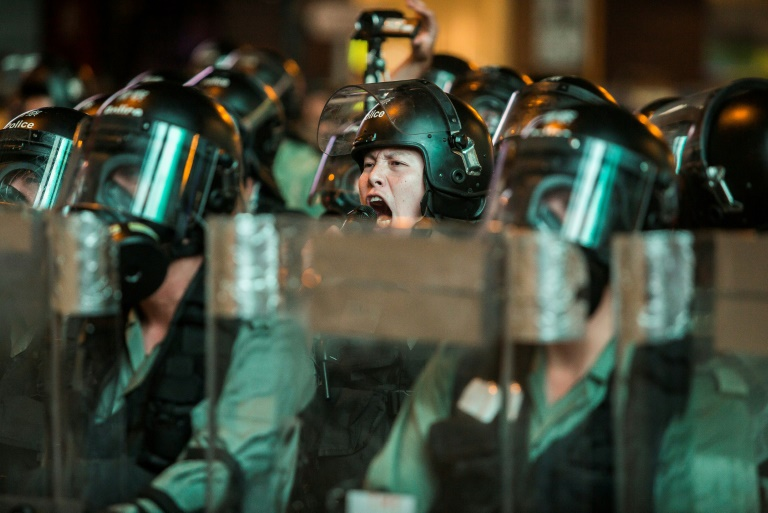 Hong Kong police fire tear gas at protesters in tourist district