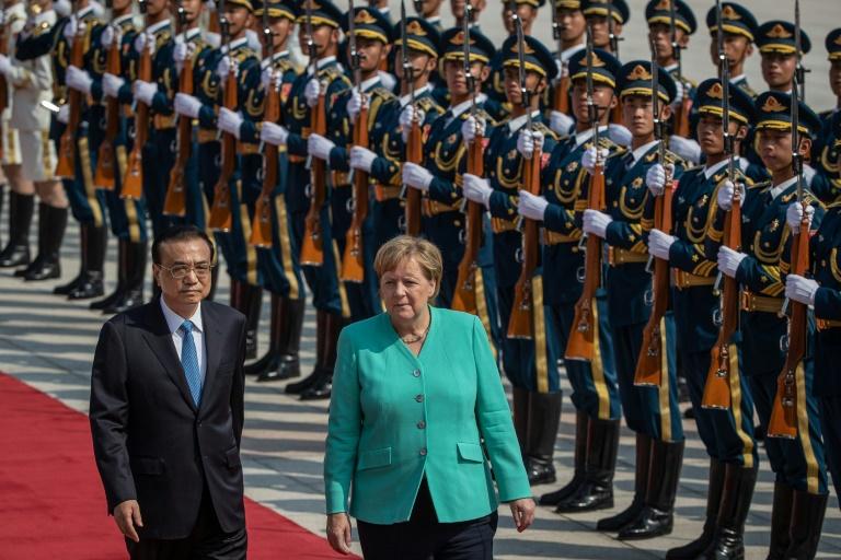 Merkel in Beijing says Hong Kong freedoms must be guaranteed
