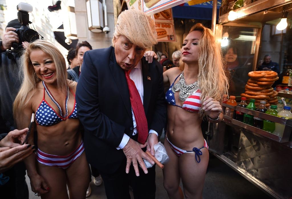 Bikini-clad models surround fake Trump in NYC stunt