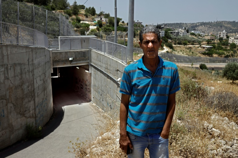 For Palestinian family, tunnel under Israel barrier leads home