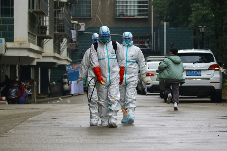 Global alarm grows as Chinas capital reports first virus death