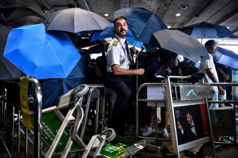 Hong Kong protesters target airport as city mops up