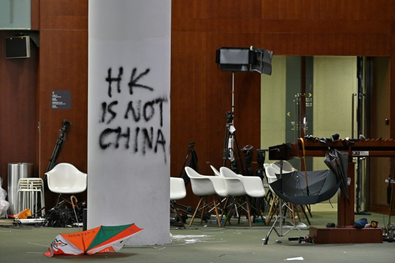Hong Kong police vow action over parliament storming