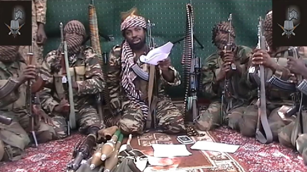 """Boko Haram leader Abubakar Shekau (C) has said all schoolgirls abducted have converted to Islam and been """"married off"""""""