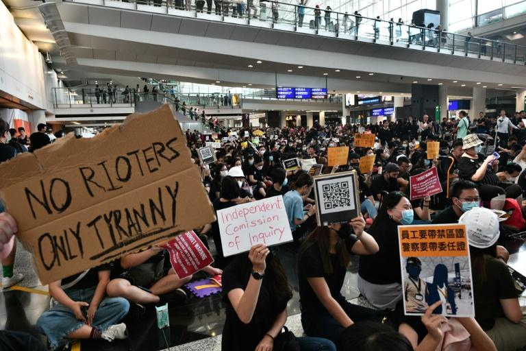 Hong Kong protesters rally at airport to educate visitors