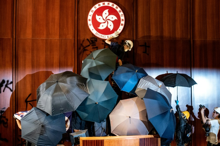 Hong Kong police retake parliament from anti-government protesters