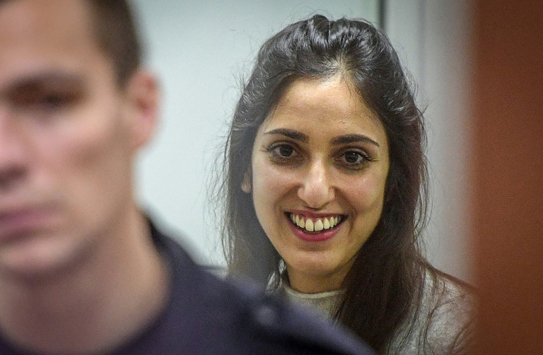 US-Israeli woman pardoned by Putin flies home with Netanyahu