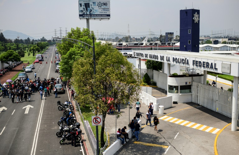 Mexico says political conspiracy behind police protest