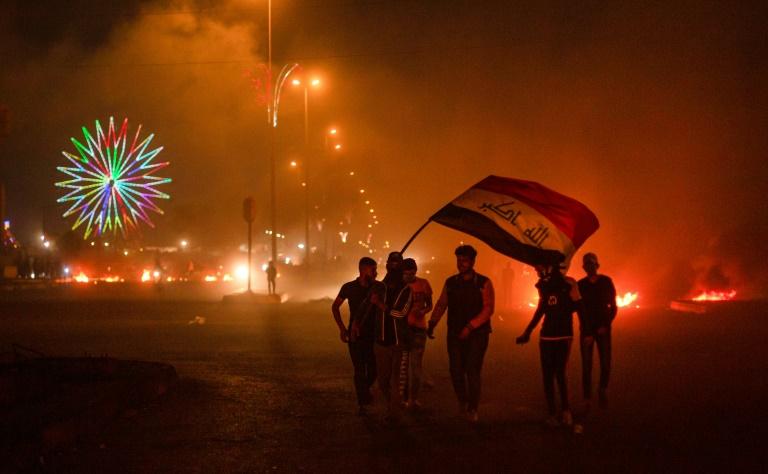 Iraqi protesters torch buildings, block roads over PM pick