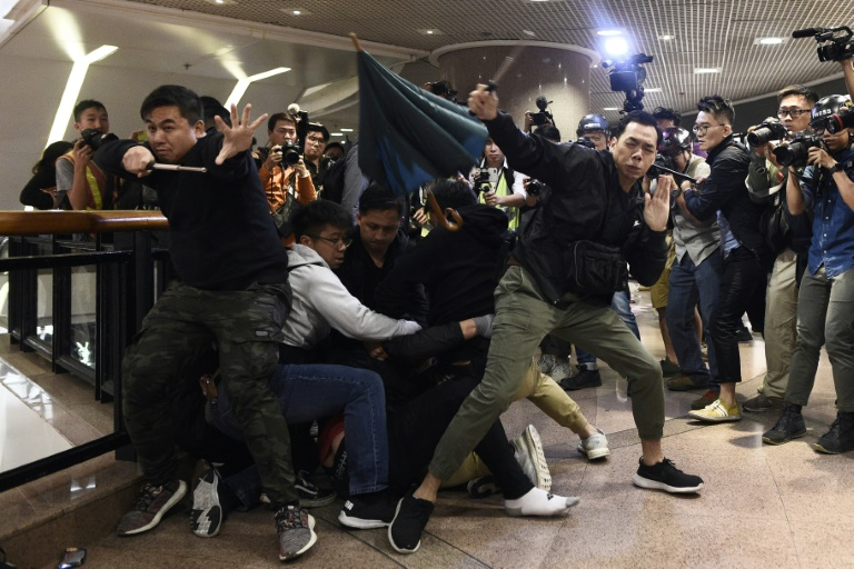 Hong Kong marks Christmas Eve with mall protests and clashes
