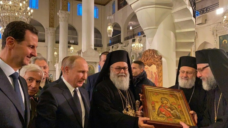 Putin on surprise visit to Assad as Mideast boils