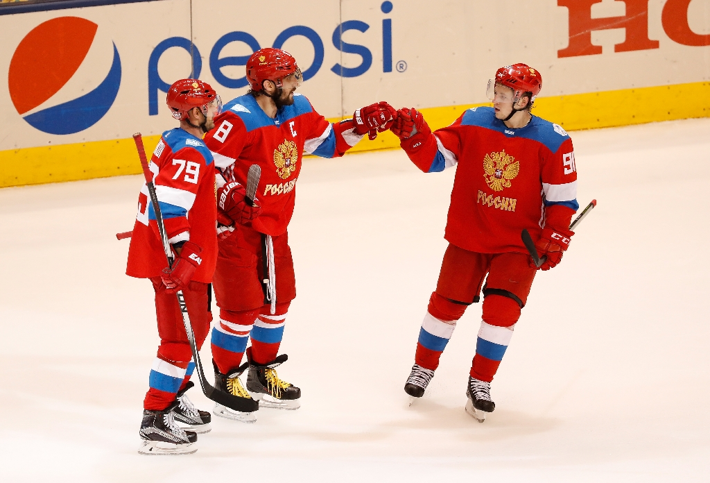 Alex Ovechkin #8 of Team Russia celebrates his third-period goal with Andrei Markov #79 and Vladimir Tarasenko #91 while playing Team Sweden during the World Cup of Hockey at the Air Canada Center on September 18, 2016 in Toronto, Canada (AFP Photo/Gregory Shamus)