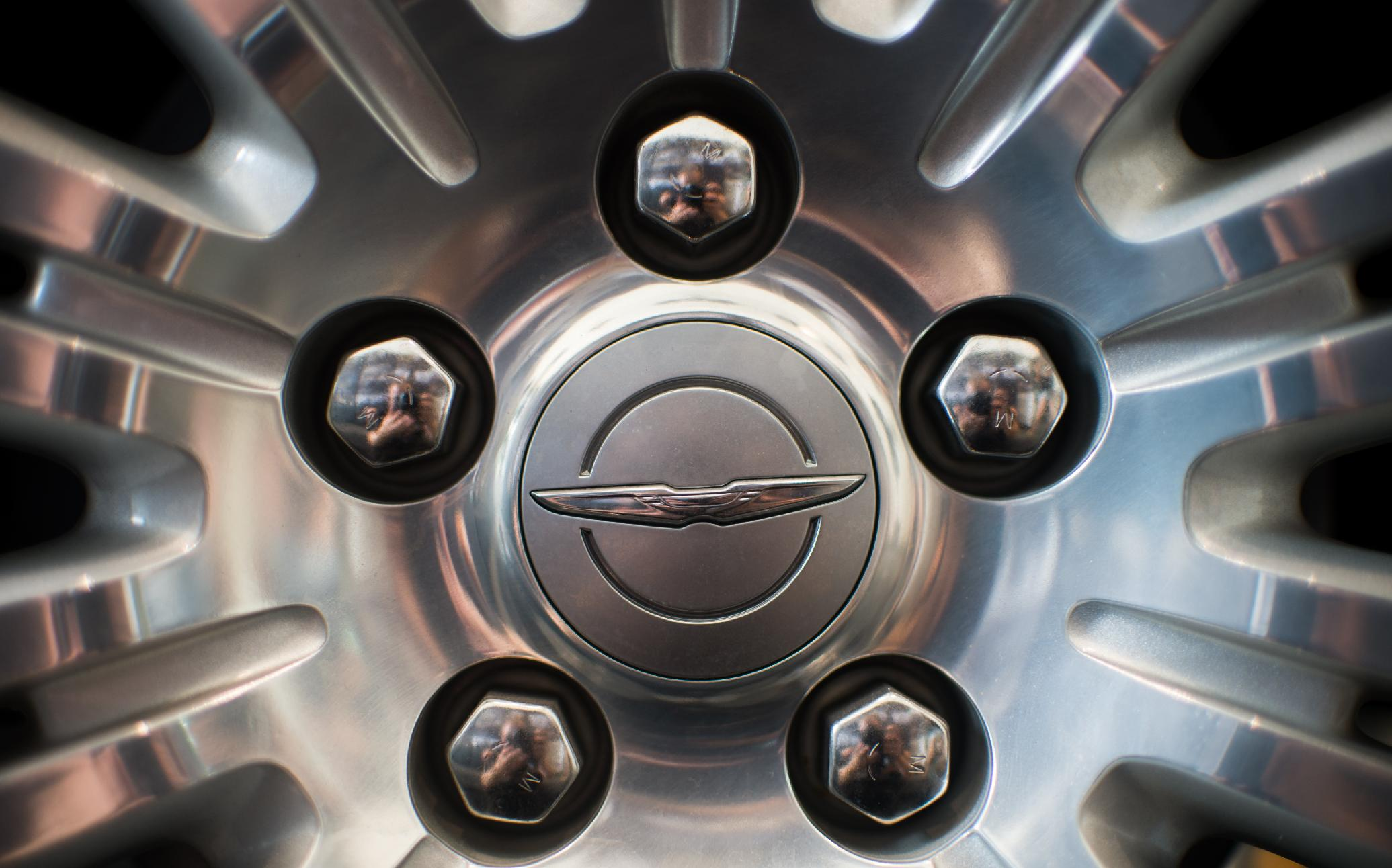 A Chrysler logo is pictured on a wheel of a car at a repair centre in Shanghai, on August 6, 2014