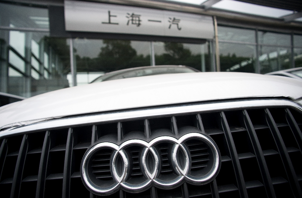 An Audi sits outside a car dealership in Shanghai on August 6, 2014