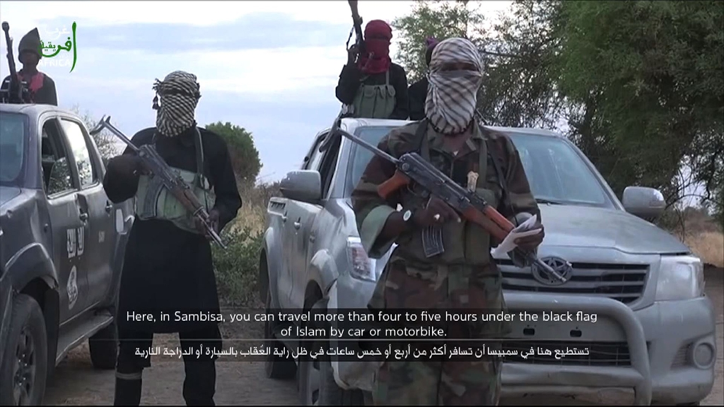 An image taken from a video posted on YouTube by Boko Haram in June 2015 purportedly shows members of the militant group armed with assault rifles