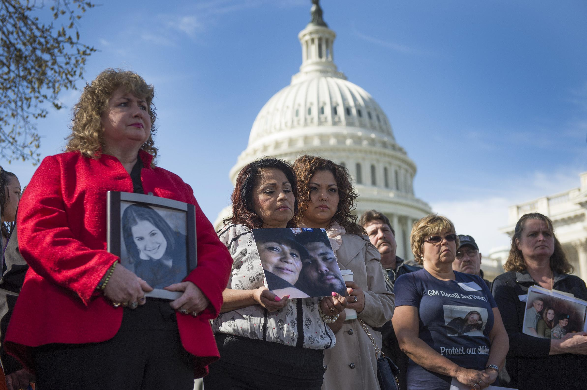 Mary Ruddy (L), whose daughter Kelly died in the crash of a 2005 Chevy Cobalt, attends a press conference with family members of deceased drivers on Capitol Hill in Washington, DC on April 1, 2014