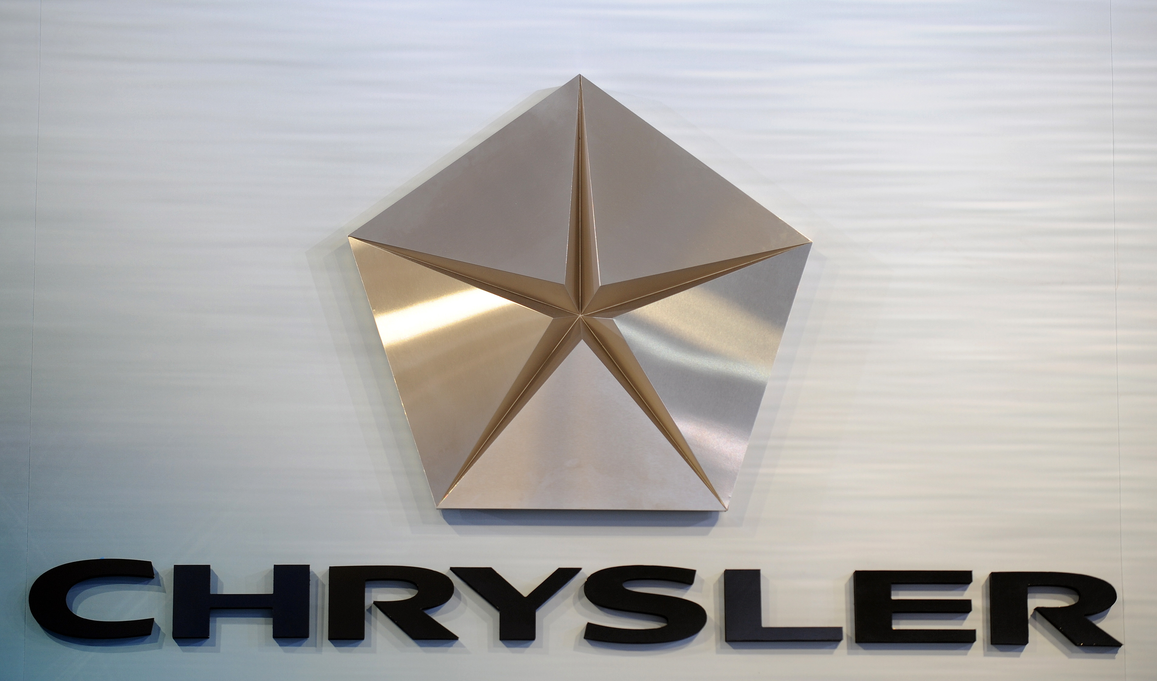The Chrysler logo is displayed during the Los Angeles Auto Show on December 2, 2009 in Los Angeles, California