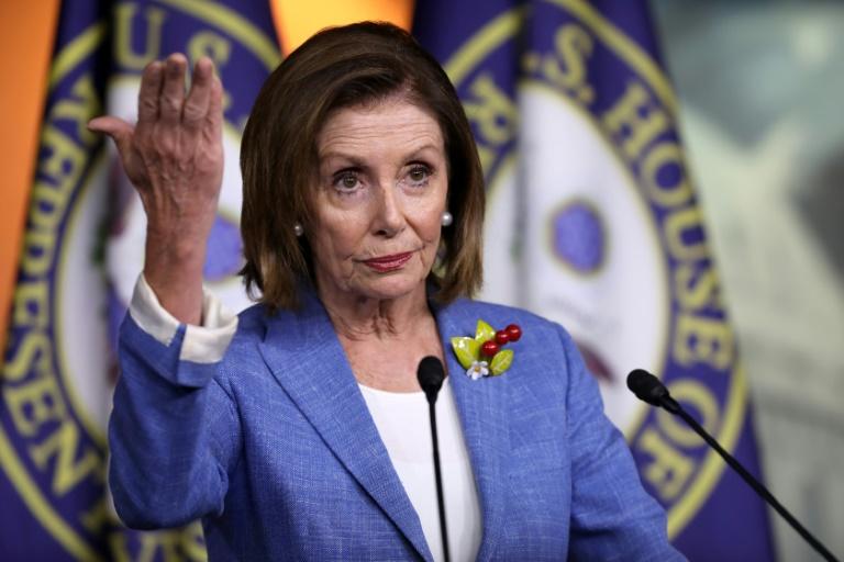 Pelosi denies curbing impeachment push as Dems seek grand jury secrets