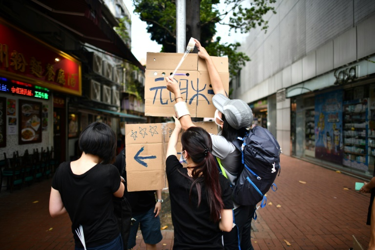 Hong Kongers defy police ban and gather for anti-triad rally