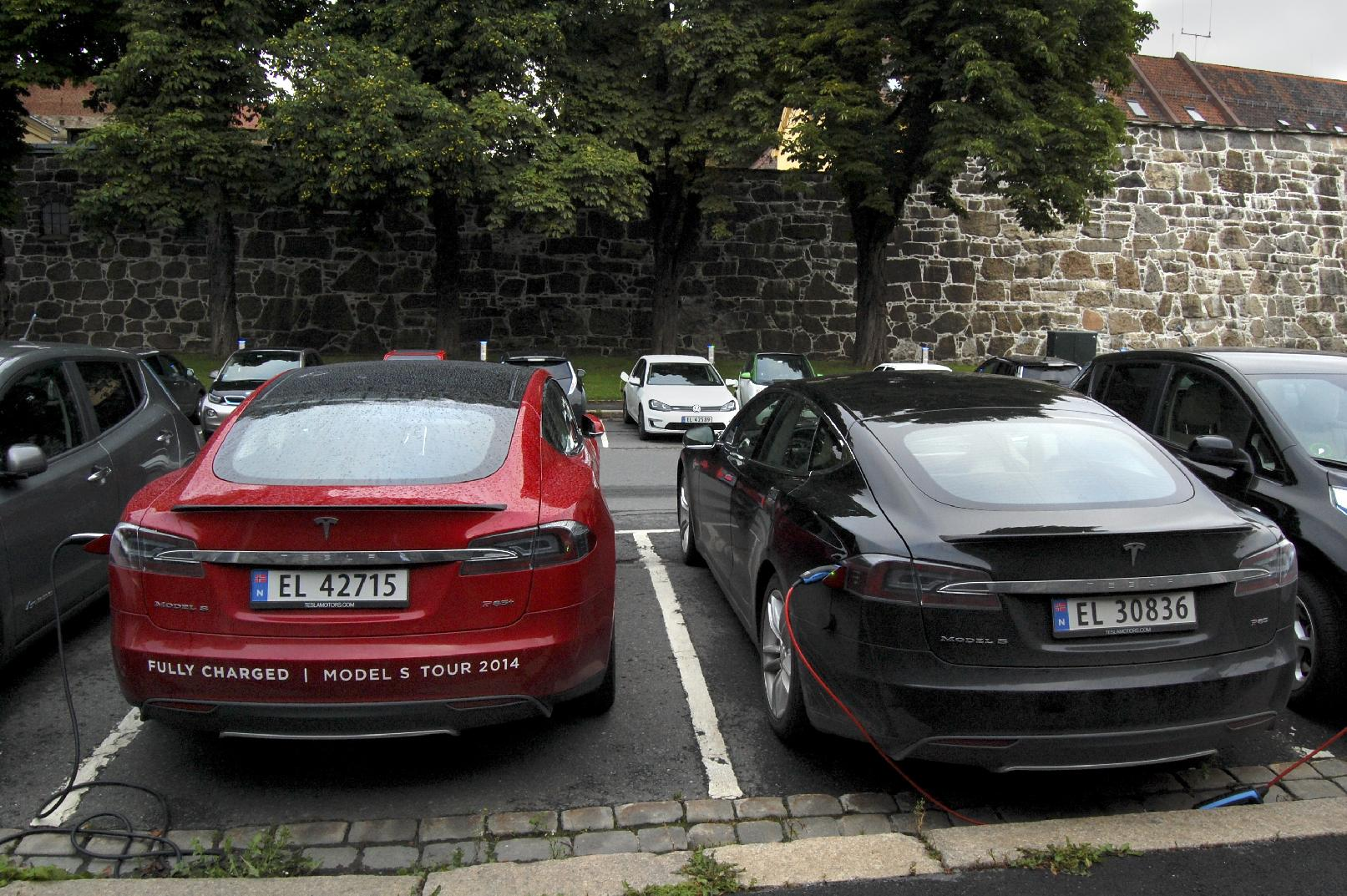 Cars are seen charging in free parking spaces for electric cars in central Oslo