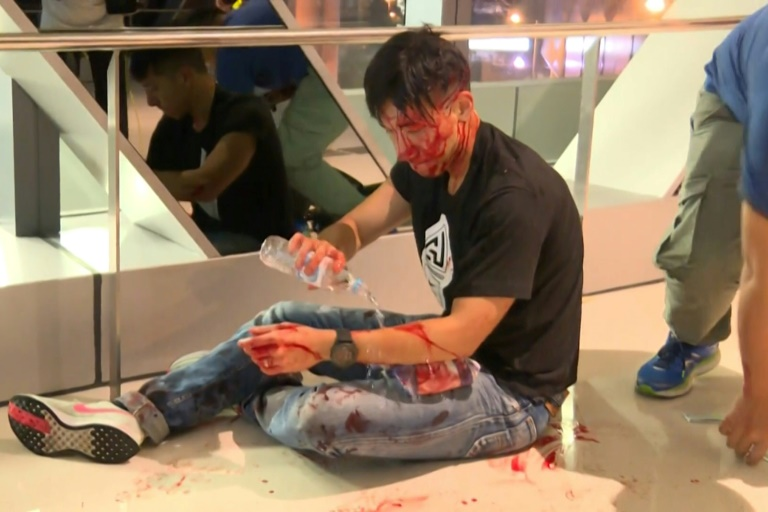 Triad attack on Hong Kong protesters sparks anger