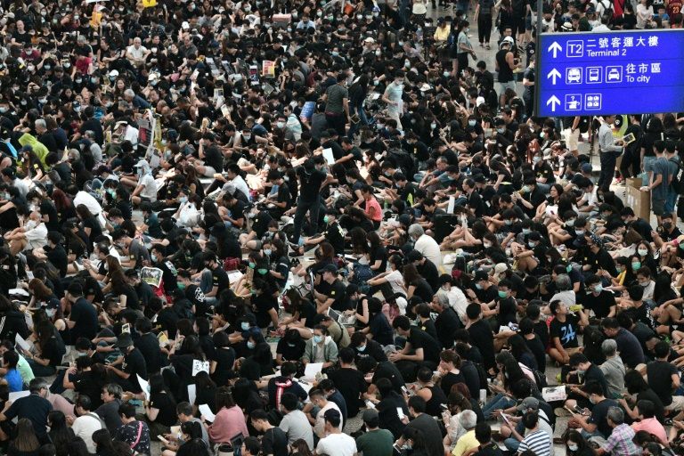 Hong Kong leader rules out concessions as protesters stage airport sit-in