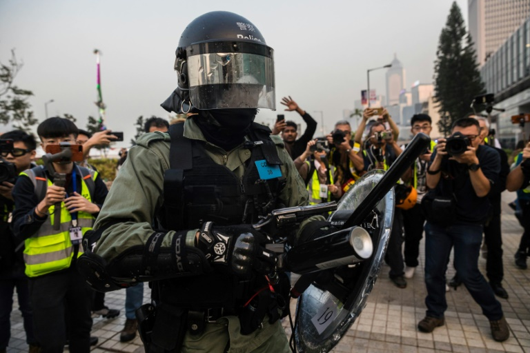 Riot police break up Hong Kong rally for Chinas Uighurs
