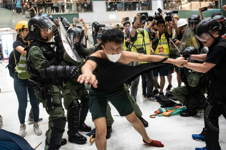 Hong Kong leader condemns rioters after violent mall clash