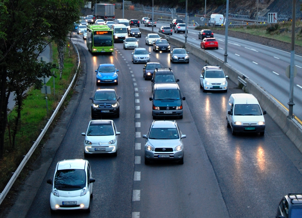 Electric cars crowd the bus lane (L) during the morning rush hour towards Oslo at Hoevik